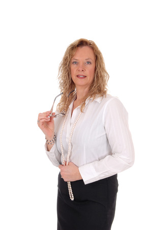 white blouse: A middle age business woman in a black skirt and white blouse standing isolated for white background.
