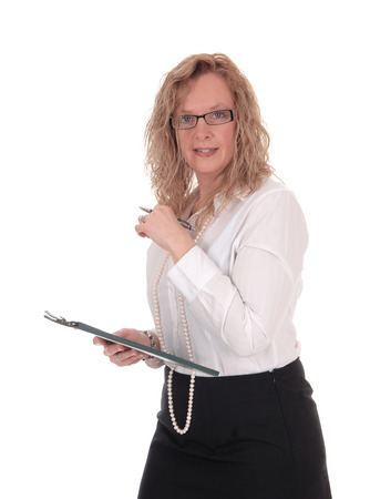 white blouse: A business woman standing in a black skirt white blouse holding her clipboard, looking into the camera, isolated for white background. Stock Photo
