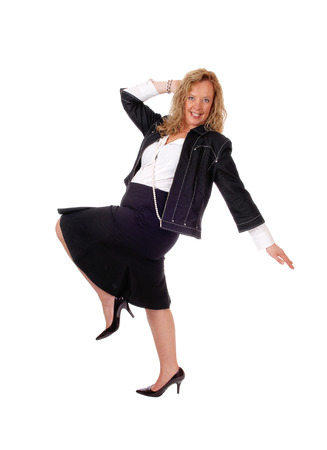 business for the middle: A middle age woman in business attire dancing, isolated  for white background.