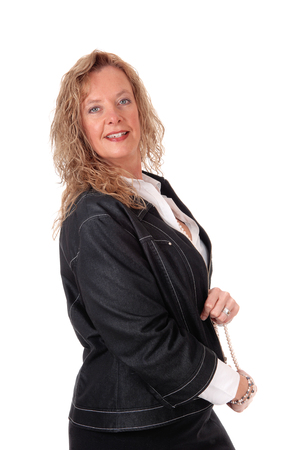 business for the middle: A middle age business woman in a black skirt and navy jacket standing in profile, isolated for white background.