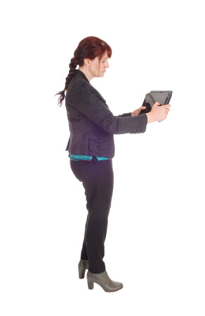 A middle age businesswoman standing and wondering what is