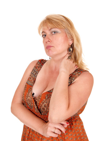 forties: A portrait image of a blond woman in her forties looking mad into the camera, isolated for white background. Stock Photo