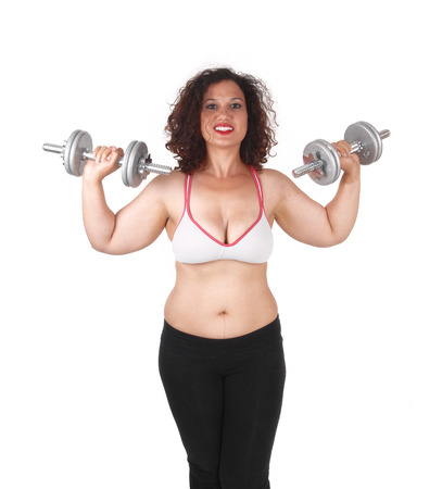 A exercising young woman lifting dumbbells in both hands, isolated for white background.