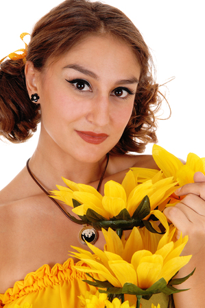 Gorgeous young woman in a yellow blouse holding a bunch of  sunflowers, smiling, standing isolated for white background.
