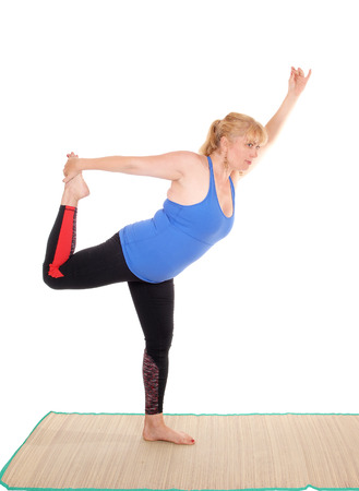 A lovely blond woman in yoga outfit showing some poses for yoga exercises, isolated for white background. Stock Photo