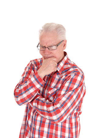 A closeup image of a white hair senior man in a checkered shirt and glasses hard thinking, isolated for white background.