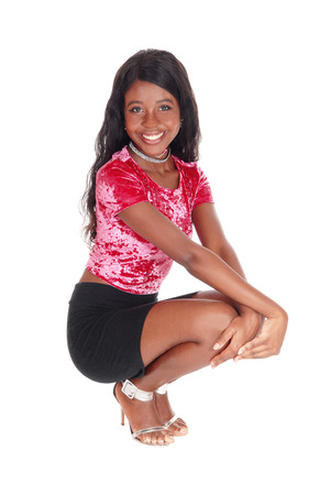 A gorges young African woman in a pink blouse and black skirt