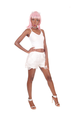 A beautiful African young woman standing in white shorts and t-shirt wondering, with a pink wick, isolated for white background