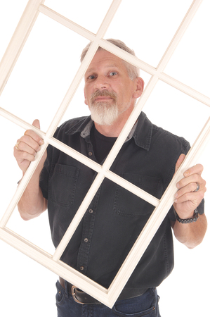 A middle age man in his forties standing in a black shirt and