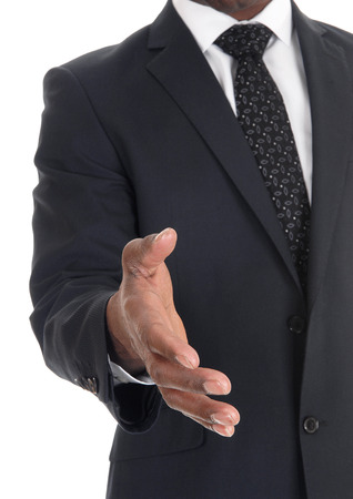 A close-up image of the hand of a business man in a dark suit greeting somebody, isolated for white background