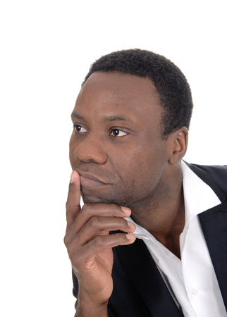 A closeup image of an African American man looking away with one hand on his chin, isolated for white background