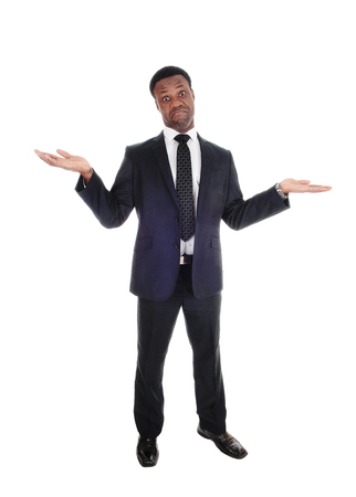 A handsome tall African American man standing in a suit with 