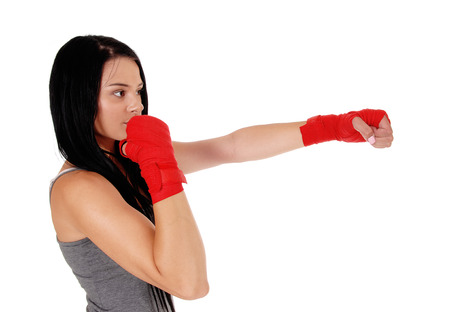 A young woman with her hands bandit standing in close up ready for