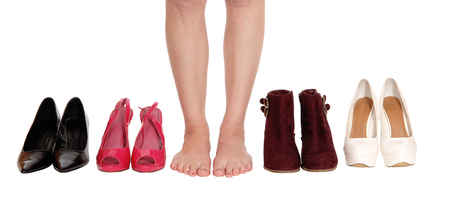 A close up image of a young woman legs standing between four pair