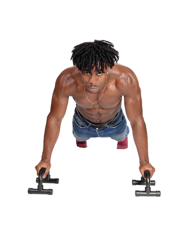 A muscular African American man working out on the floor with push aps, looking into the camera, isolated for white background 版權商用圖片