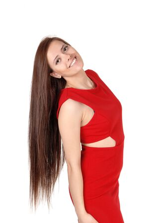 Portrait of a young beautiful woman in a red dress head back with her 