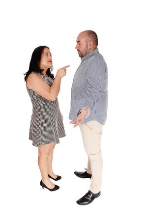 A angry wife standing for her husband and giving him a lecture, pointing her finger at him and shouting, isolated for white background Stock fotó