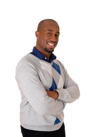 A handsome young African American man standing in a sweater in  profile, looking into the camera, isolated for white background Reklamní fotografie
