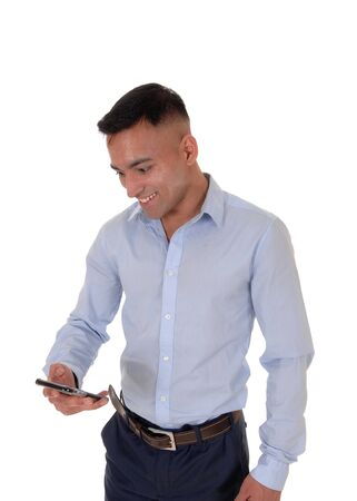 A young man is looking at his smart phone and is very happy about the message he got, isolated for white background