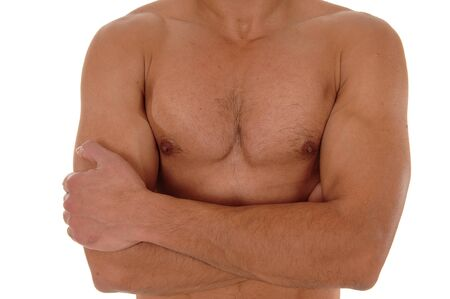 A close up image of the chest of a young handsome man with his arms crossed, isolated for white background