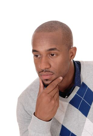 A young handsome African American man sitting in the studio with 