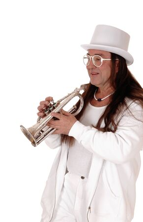A middle age indigenous man standing in a white outfit and white hatplaying his trumpet with his long hair, isolated for white background