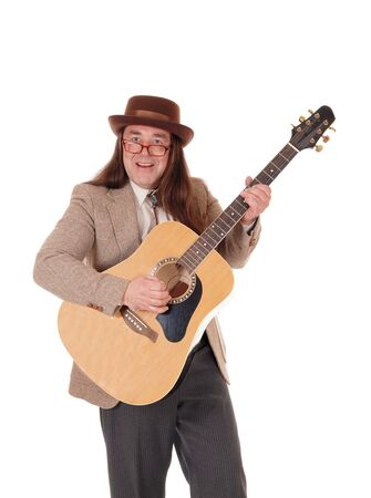 A handsome indigenous man in a jeans jacket, pants and a cowboy hat