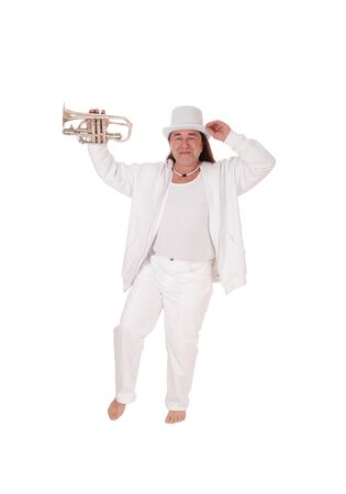 A middle age indigenous man dancing in a white outfit and white hat