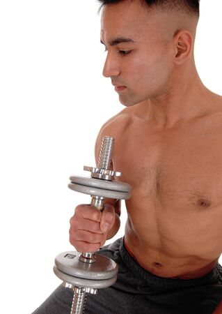 A handsome shirtless young man working out with a dumbbell with his eyes closed, wearing his truck pants, isolated for white background Reklamní fotografie