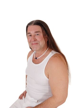 A happy indigenous man posing for a portrait image withhis long brunette hair, isolated for white background