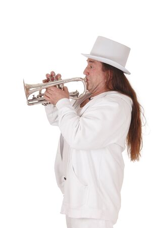 A middle age indigenous man standing in a white outfit and white hat