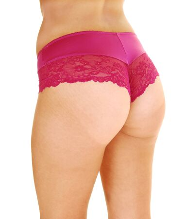 A nice bottom of a young woman standing from the back in her burgundypanties, isolated for white background