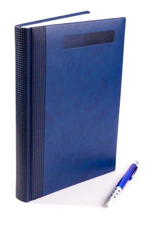 Isolated blue notebook and blue pen on a white background
