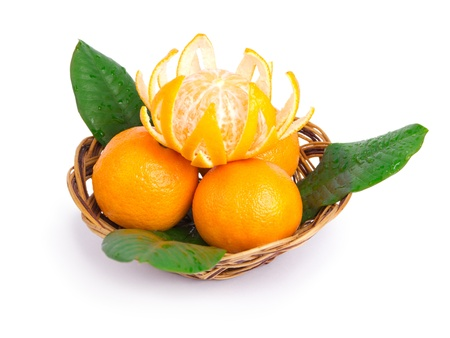 Tangerines in a wattled plate isolated on a white background