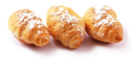 Croissant covered with powdered sugar Stock Photo