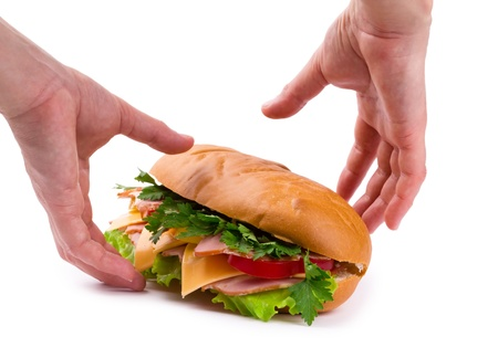 andwich with a ham, paprika and cheese in hands isolated Stock Photo
