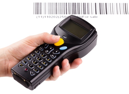 Electronic manual scanner of bar codes in woman hand Stock Photo - 8802897