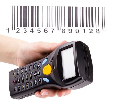 data warehouse: Esc�ner manual electr�nico de c�digos de barras en la mano de la mujer