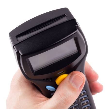 Electronic manual scanner of bar codes in man hand Stock Photo - 8802898