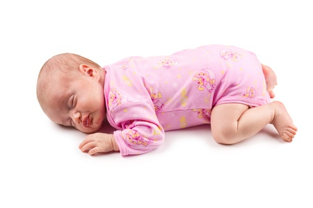 motherhood: The sleeping newborn baby girl in pink isolated on a white background Stock Photo