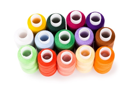 Spools multi-colored threads standing group isolated on a white background Stock Photo