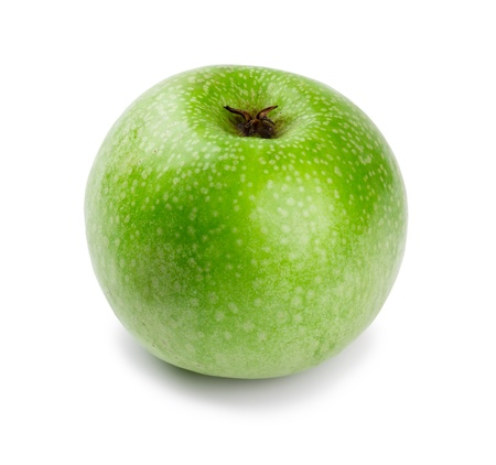 Ripe and juicy green apple a shank downwards isolated on a white background
