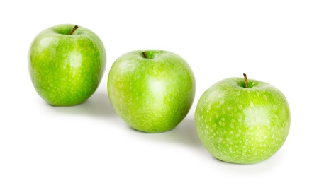 Three ripe and juicy green apples located in a line isolated on a white background Stock Photo