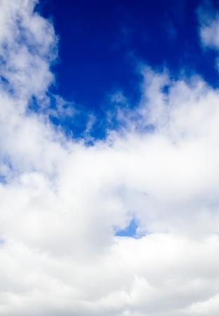 The dark blue sky behind dense clouds Stock Photo