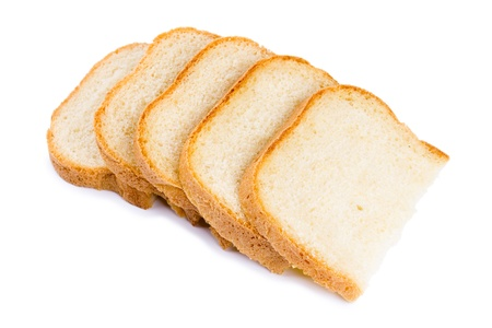 Fresh hot slices of home-made bread isolated on a white background