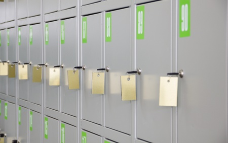 Gray metal lockers for storage of things with keys