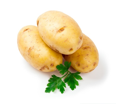 Three new potatoes with parsley leaf isolated on white background close up