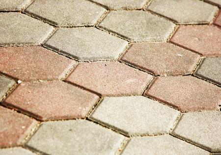 correlate: The arrangement of the brick walkway