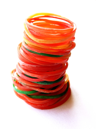 stretchy: A picture of colourized rubber rings  rubber bands  stacked together with a white background to use as a reference picture  Stock Photo