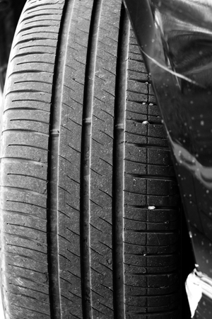 slipped: Old car tyre  tire  monochrome Stock Photo